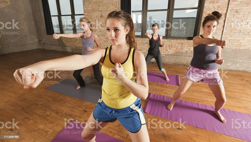 Kick Boxing Martial Arts Exercise Woman Sport Group Workout Training stock photo