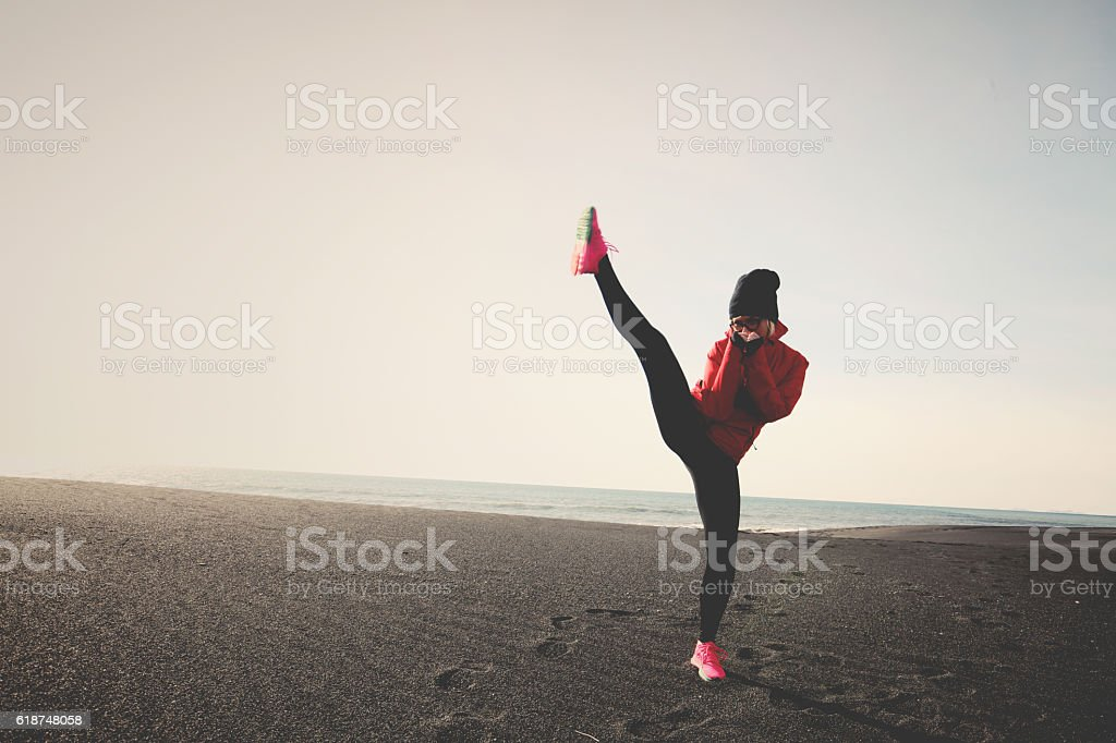 kick boxing on the beach stock photo