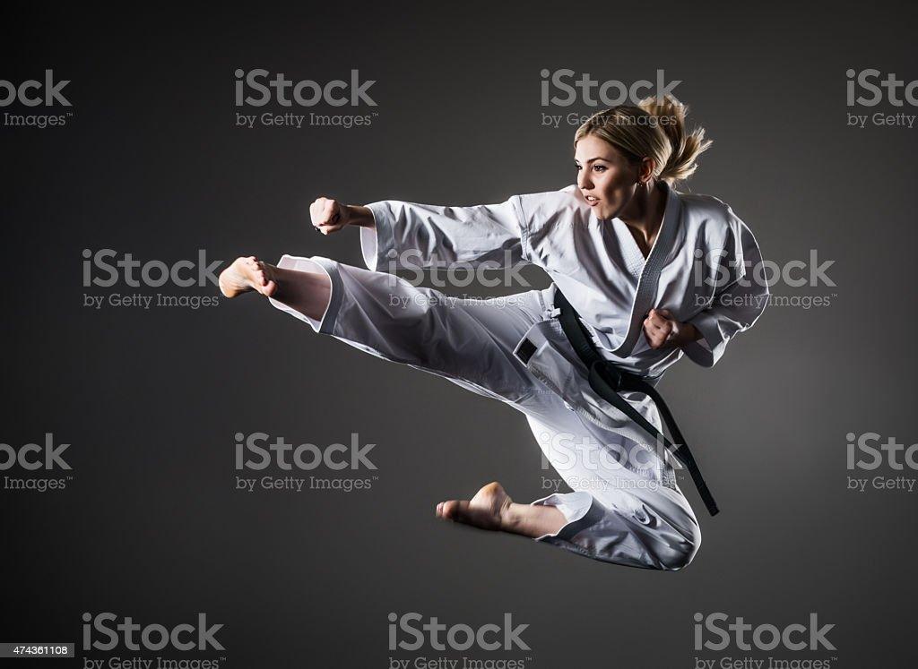 Kick in jump stock photo