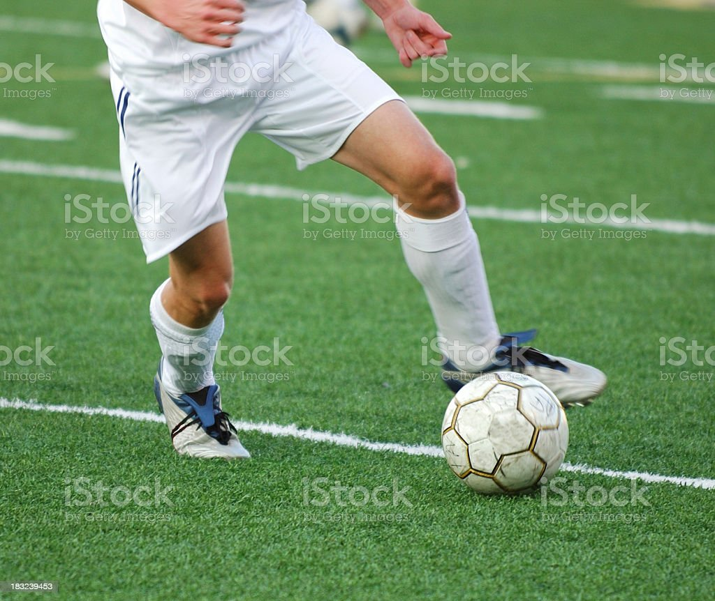 Kick in the Grass royalty-free stock photo
