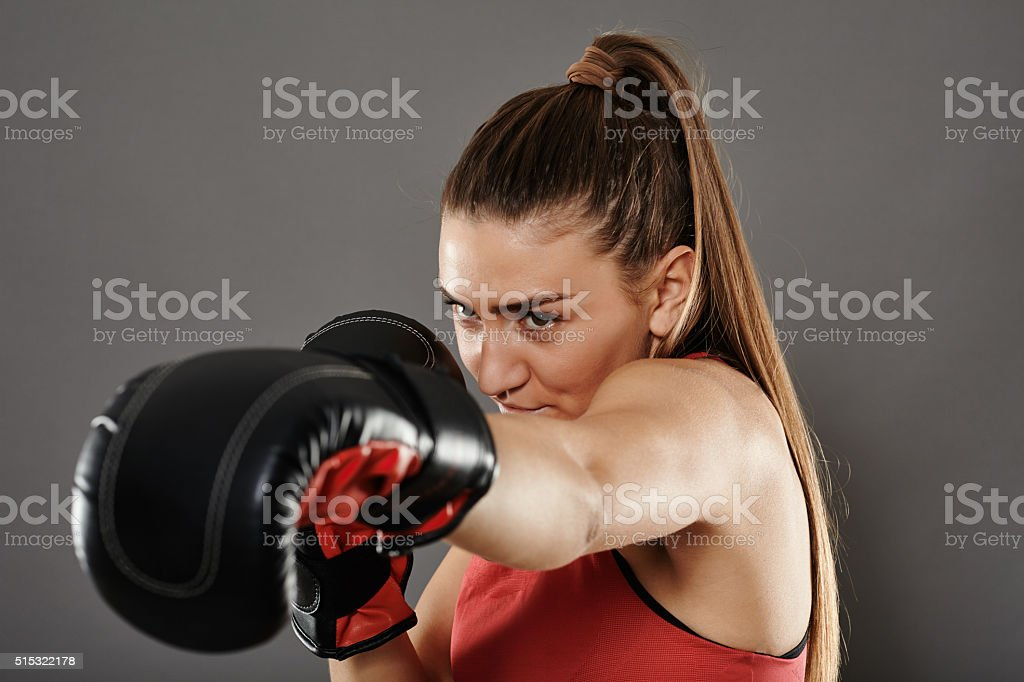 Kickbox woman left jab stock photo