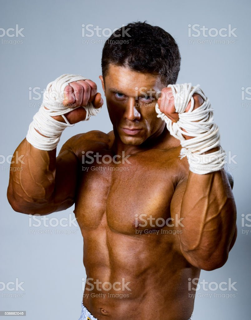 Kick-boxer in fighting stance stock photo