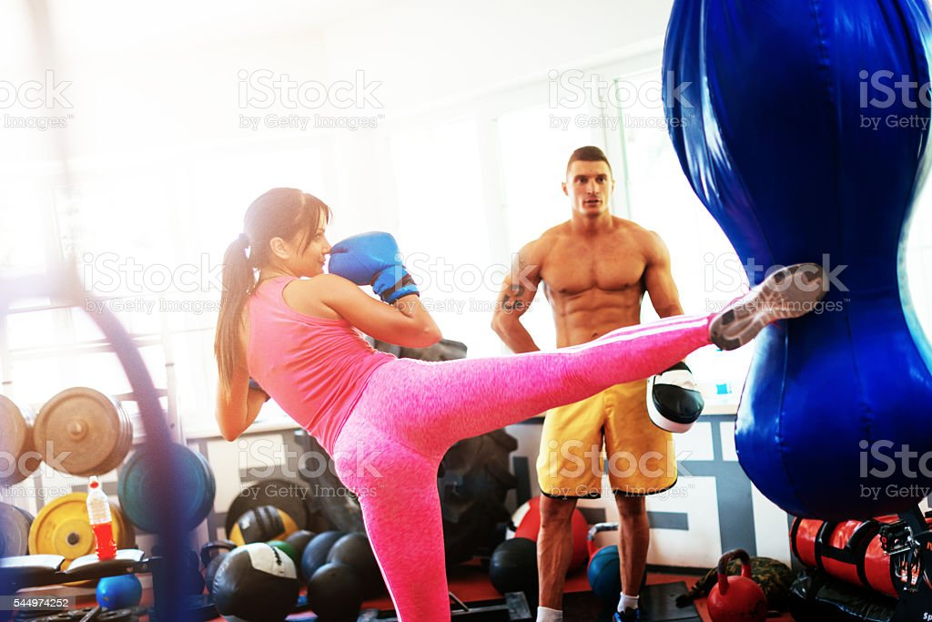 Kick-boxing and taekwondo training in gym stock photo