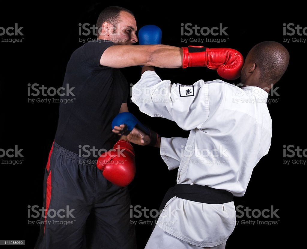 Kickboxing versus karate royalty-free stock photo
