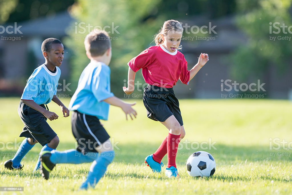Kicking a Ball Up the Field stock photo