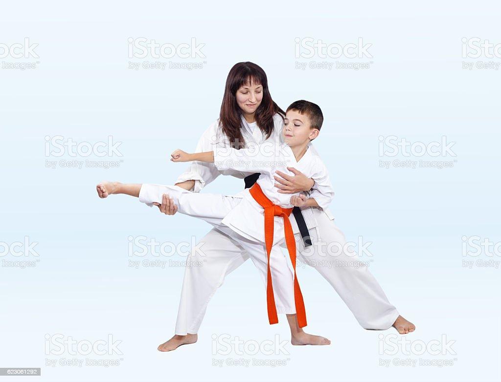 Kicking aside athlete helps beat mom coach stock photo