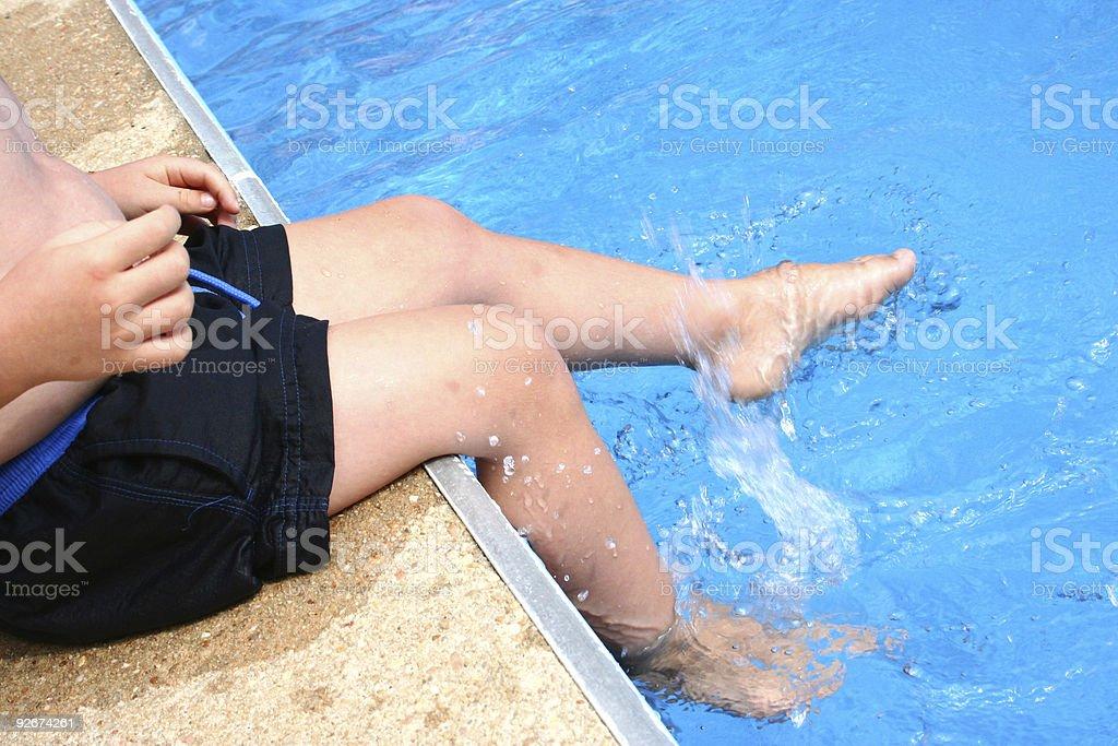 Kicking Feet in Pool royalty-free stock photo