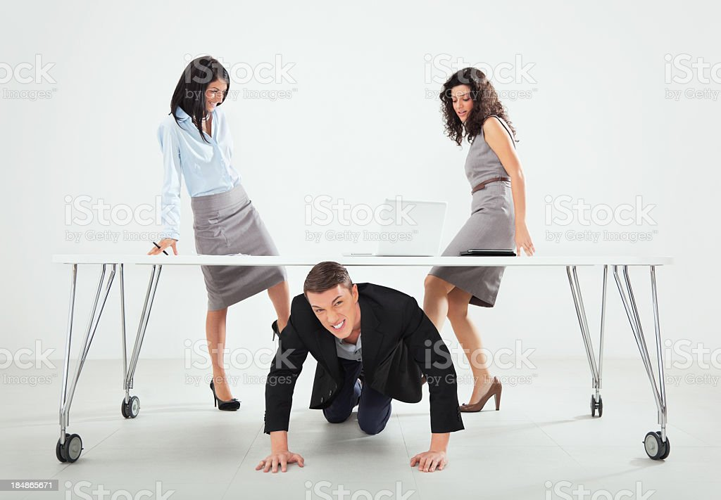 kicking male colleague royalty-free stock photo