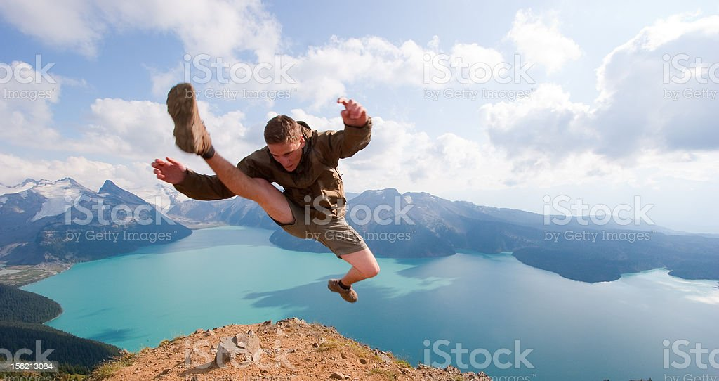 Kicking on the peak royalty-free stock photo