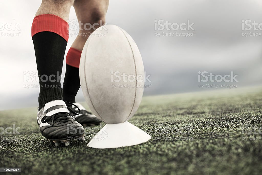 Kicking rugby ball. stock photo