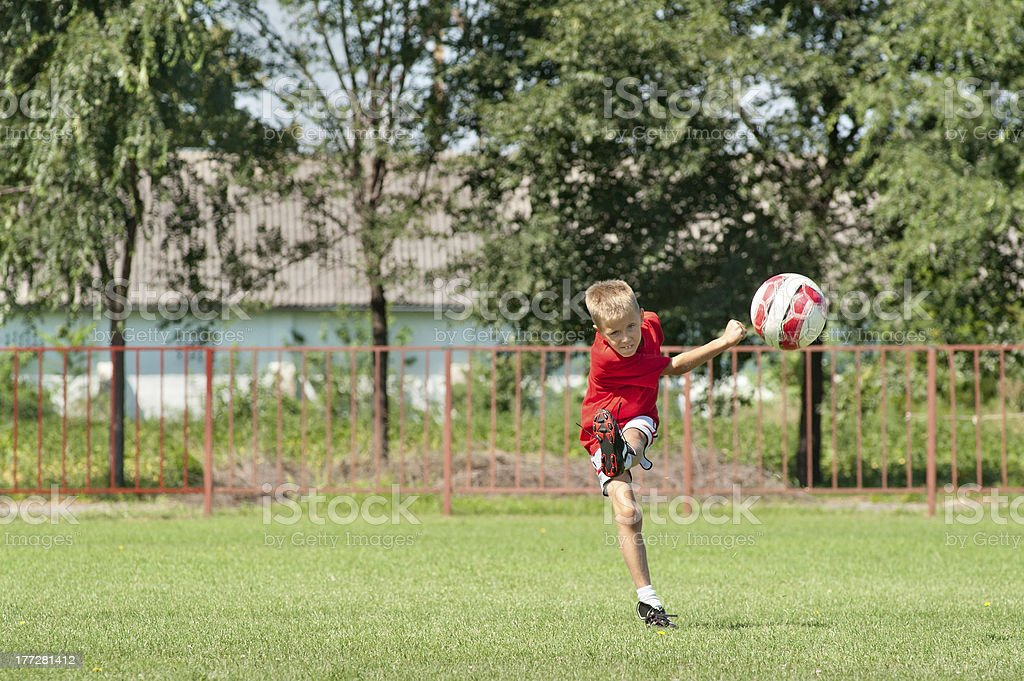 Kicking soccer ball royalty-free stock photo