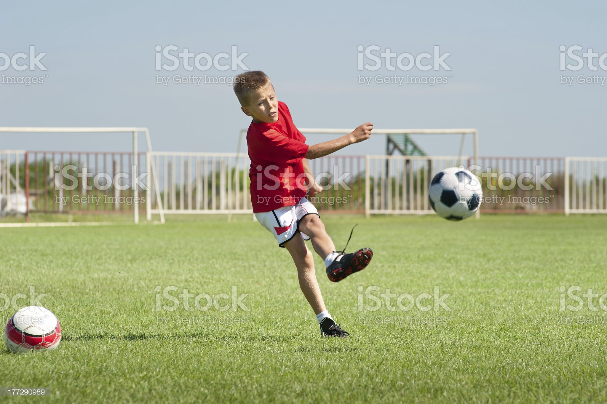 Kicking soccer ball royalty-free stock photo