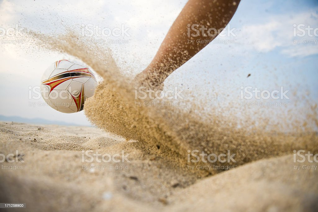 Kicking the ball with sand stock photo