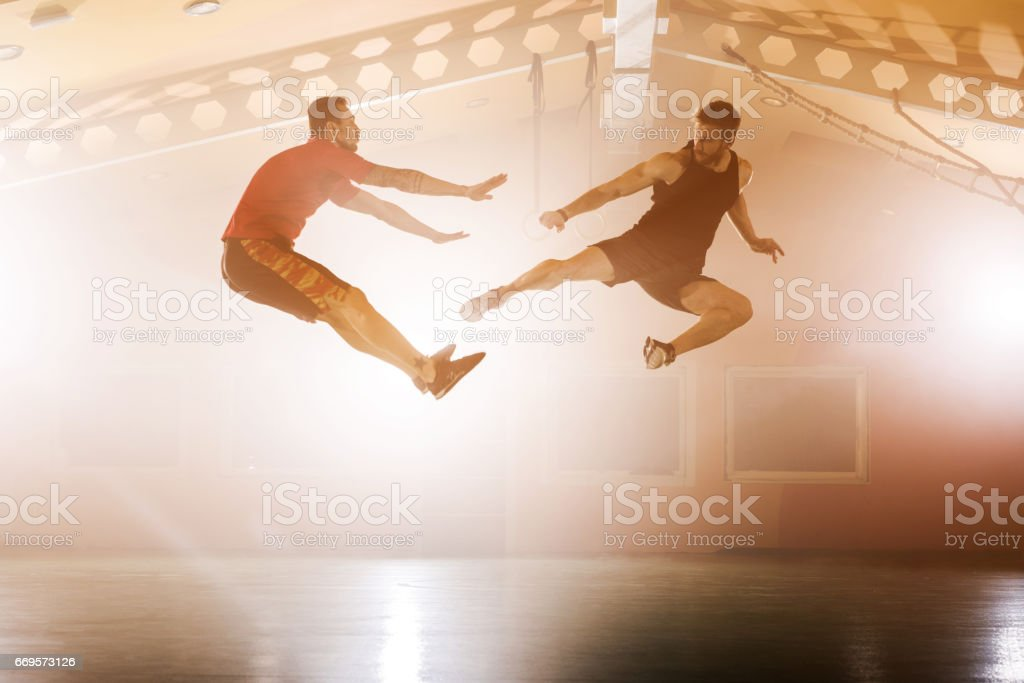 Kicking the opponent in the air! stock photo