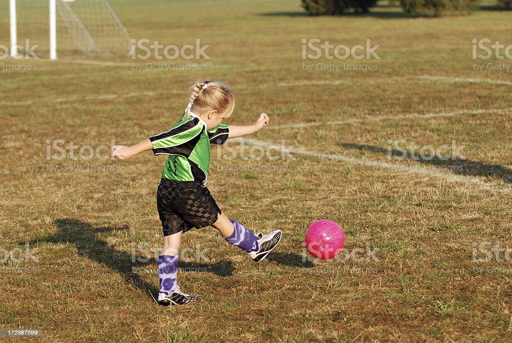 Kicking the Soccer Bal royalty-free stock photo