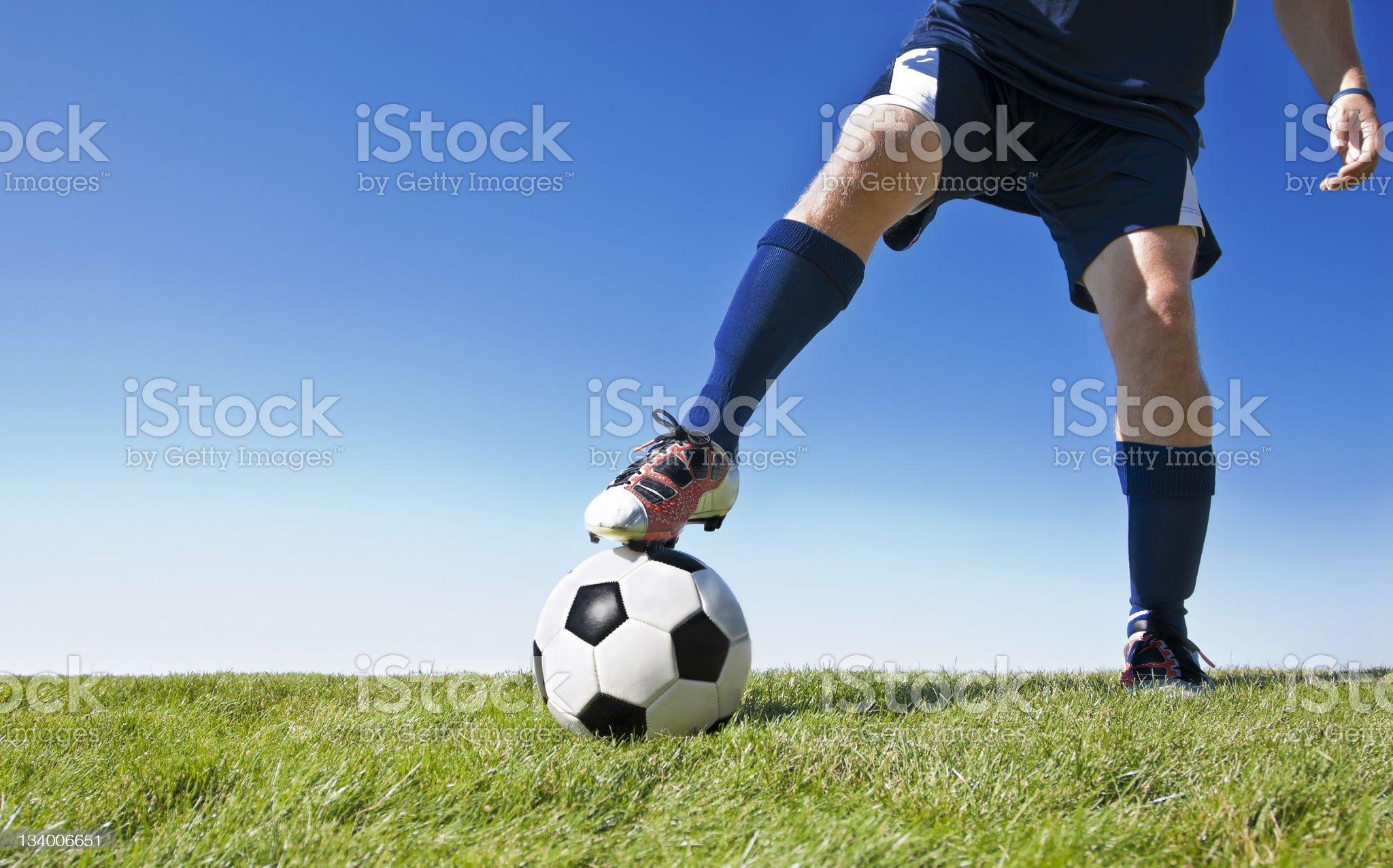 Kicking the soccer ball - Horizontal royalty-free stock photo