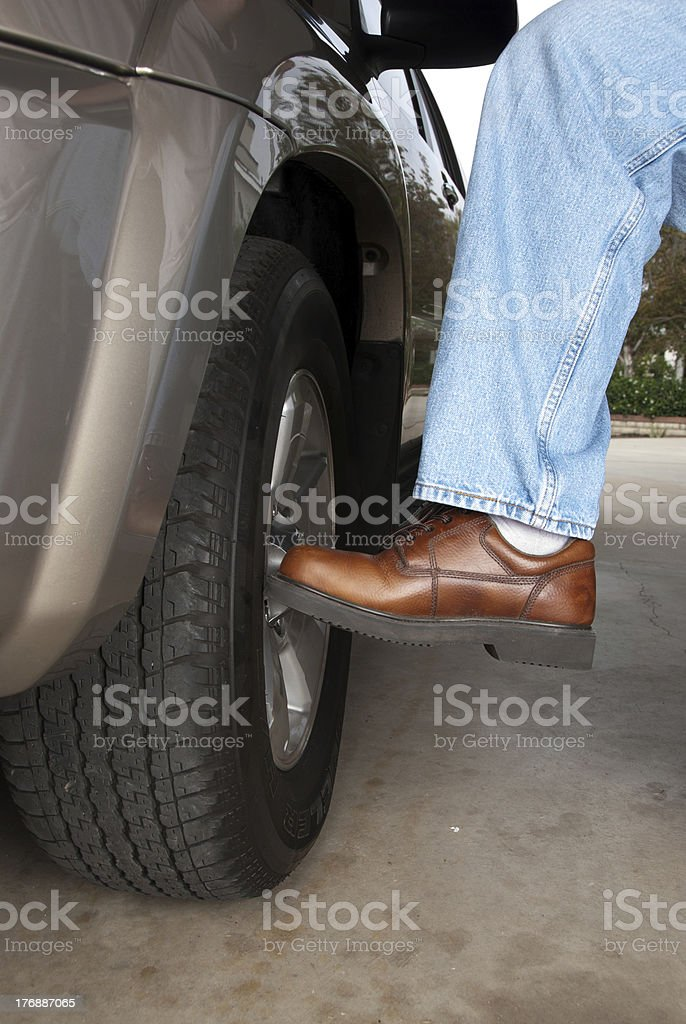 Kicking the tire stock photo