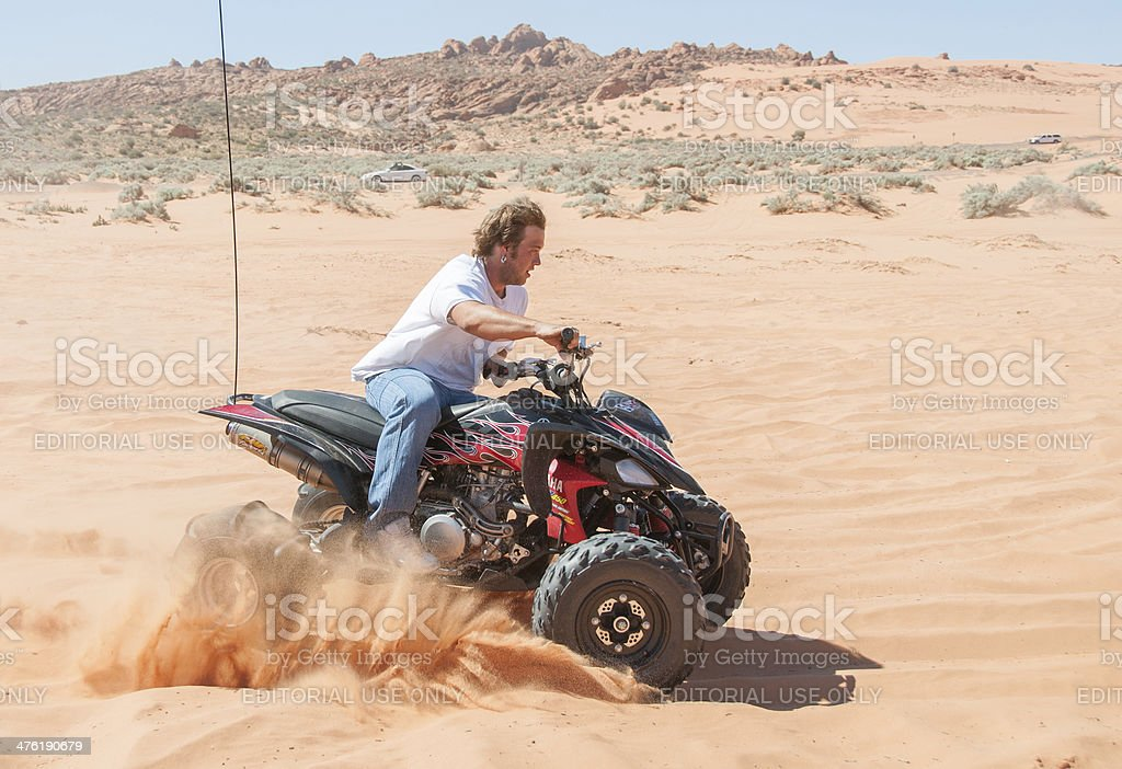 ATV kicking up sand in Utah royalty-free stock photo