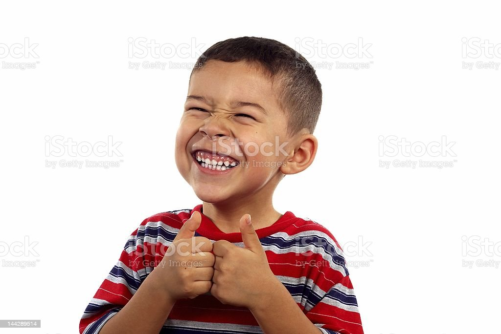 kid 6 years old silly face thumbs up stock photo