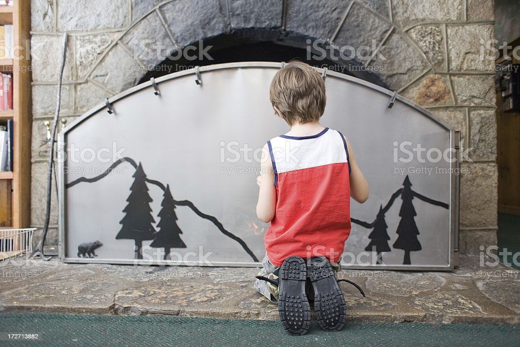 Kid And Fireplace royalty-free stock photo