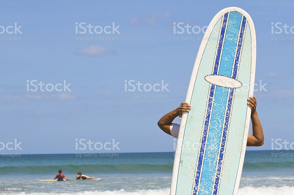 kid and his surfboard on the beach royalty-free stock photo