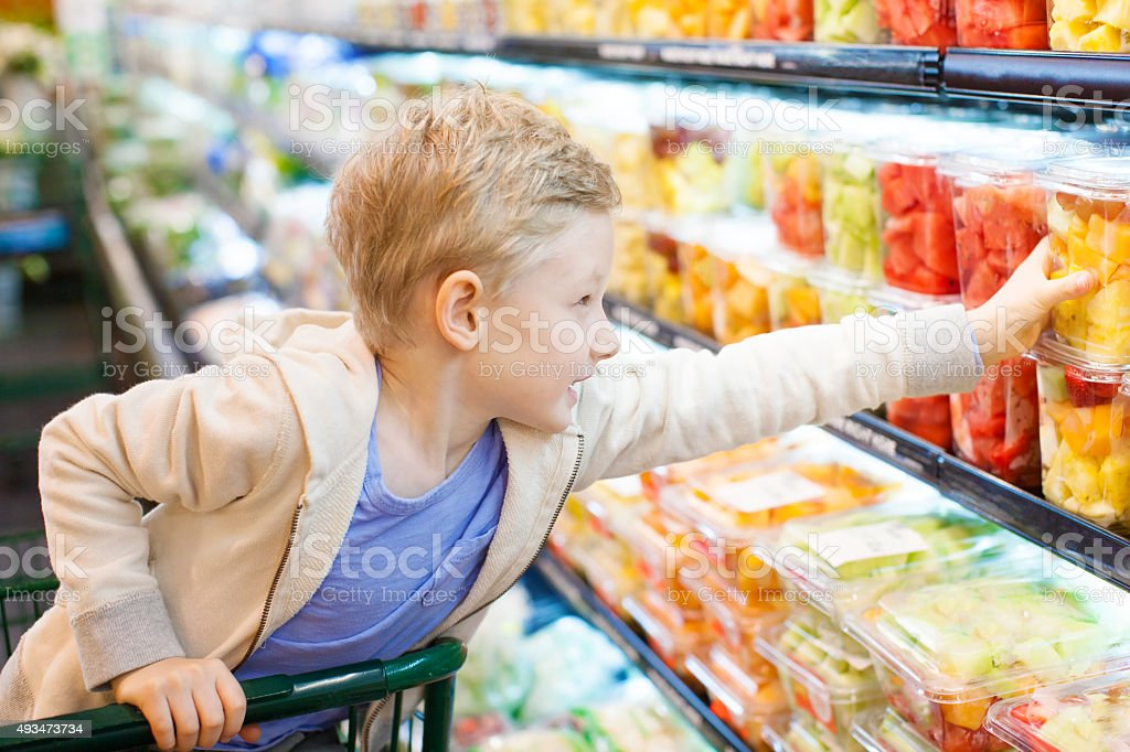 kid at grocery store stock photo