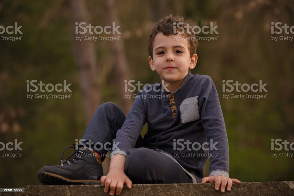 kid descends the stairs stock photo