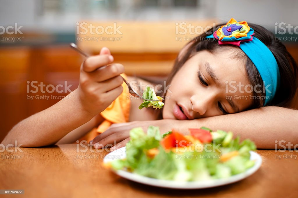 Kid disliking food royalty-free stock photo