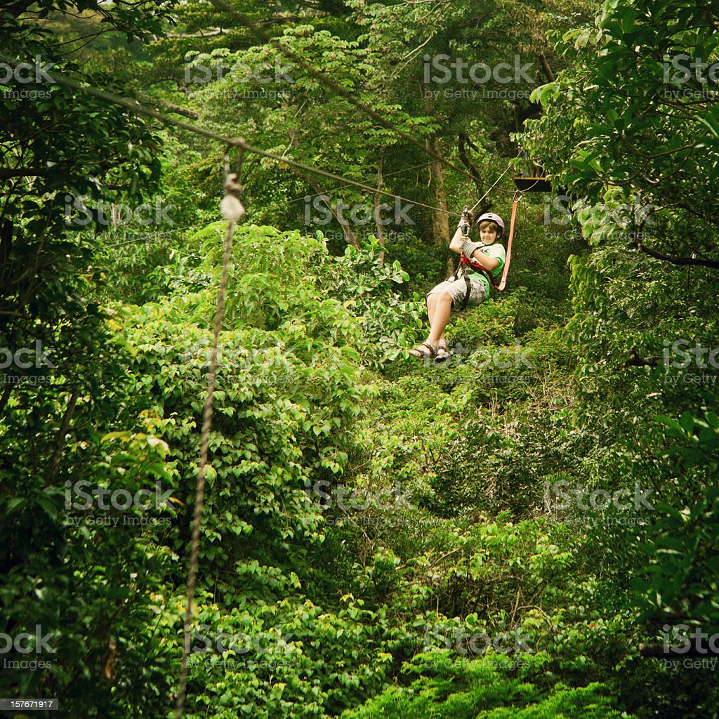 kid during a Canopy Tour Costa Rica stock photo