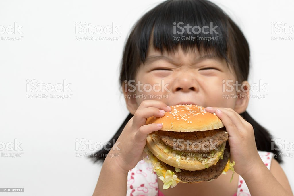 Kid eating big burger stock photo