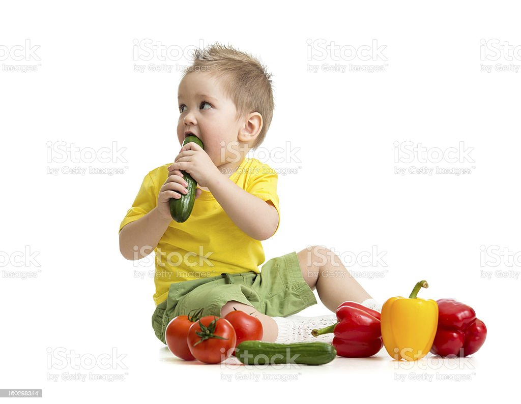 kid eating healthy food and looking aside royalty-free stock photo