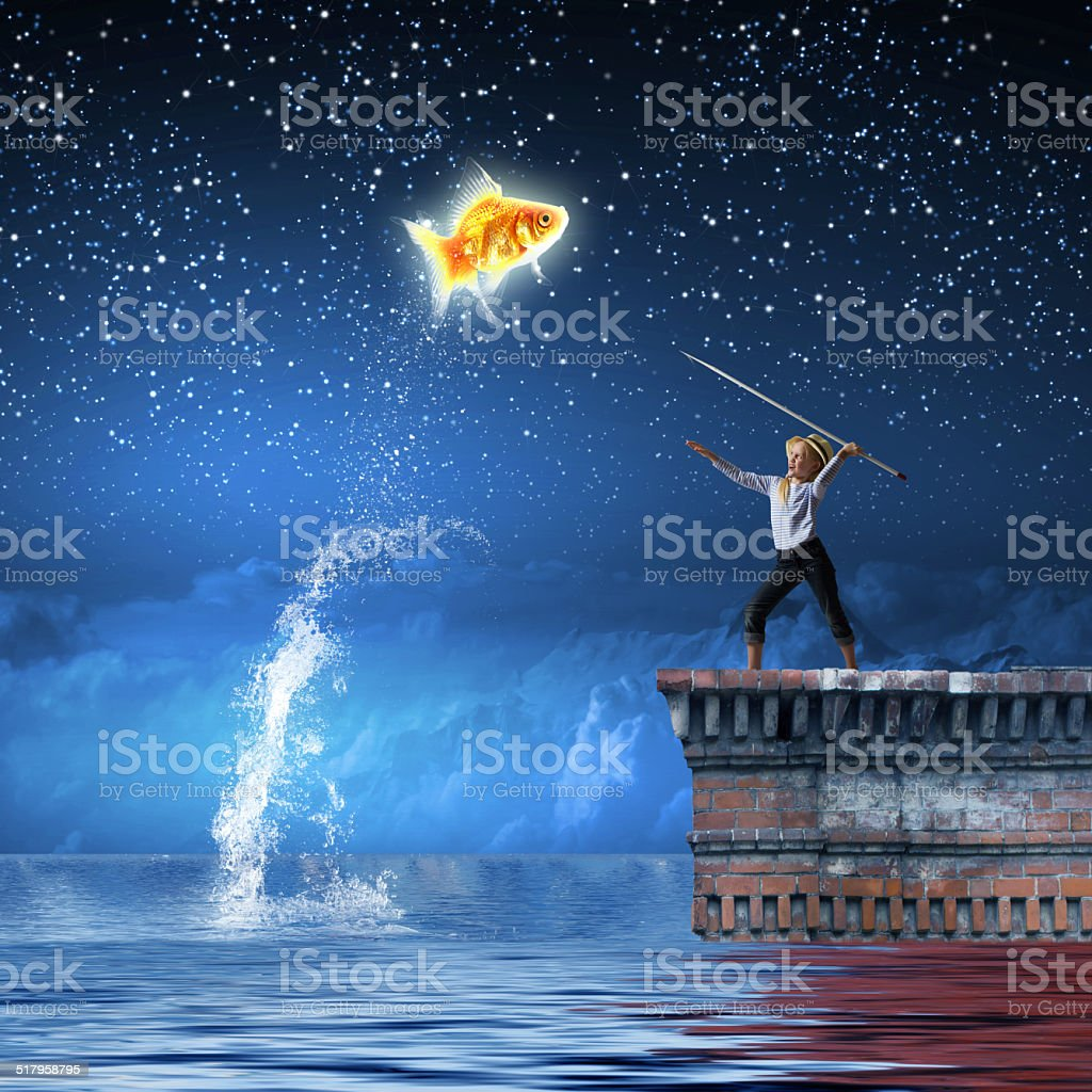 Kid fisherman stock photo