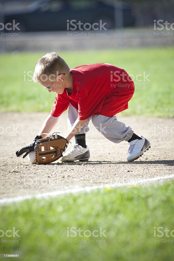Kid getting grounder stock photo