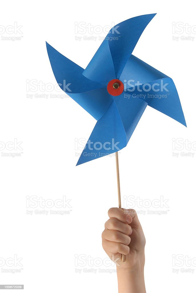 Kid hand with blue windmill stock photo