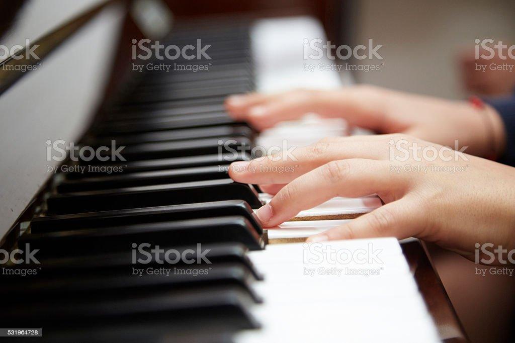 kid hands on piano stock photo