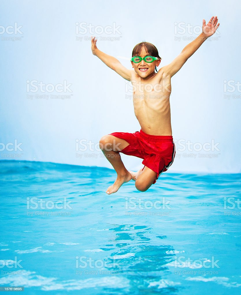 kid having a good time in the pool royalty-free stock photo