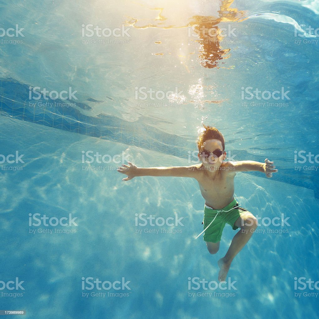 kid having a good time in the pool stock photo