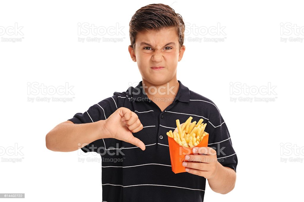 Kid holding a bag of fries stock photo