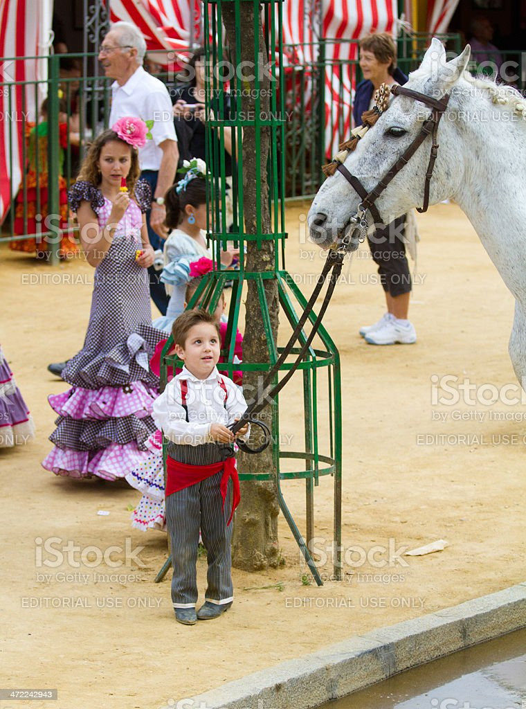 Kid holding a horse at the Seville Fair stock photo