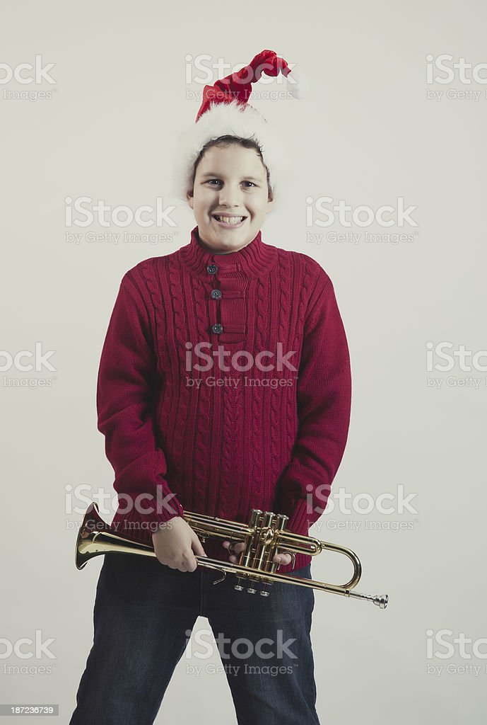 kid holding a trumpet royalty-free stock photo