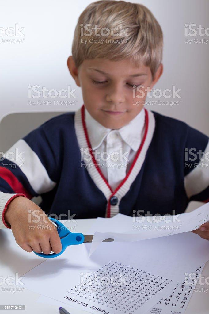 Kid holding scissors stock photo