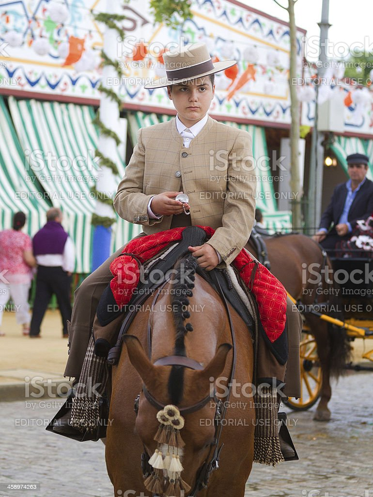 kid horse ridding during the April Fair in Seville royalty-free stock photo