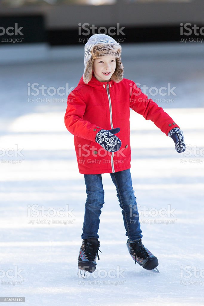 kid ice skating stock photo