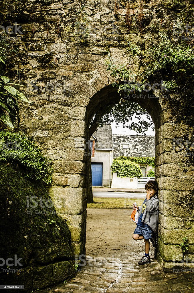 Kid in a arch door stock photo