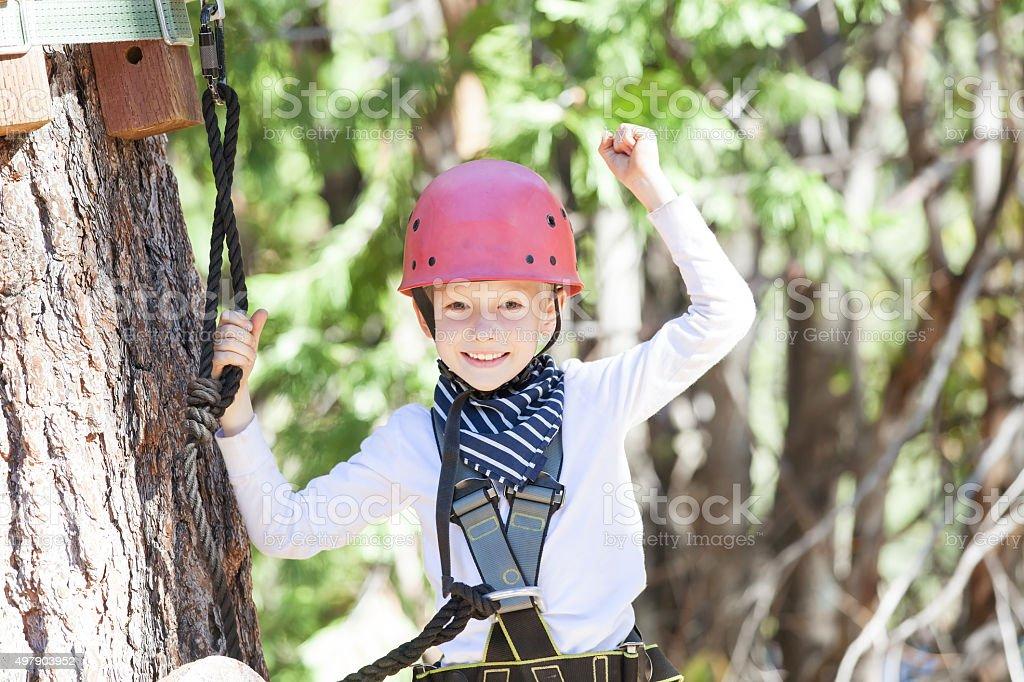 kid in adventure park stock photo