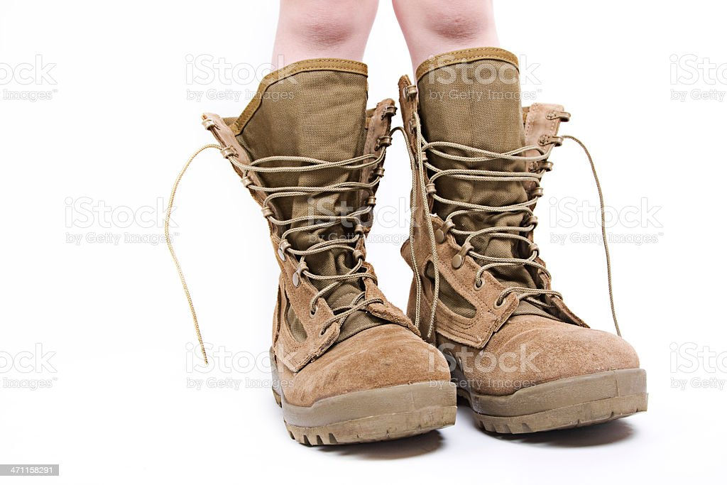 Kid in Boots stock photo