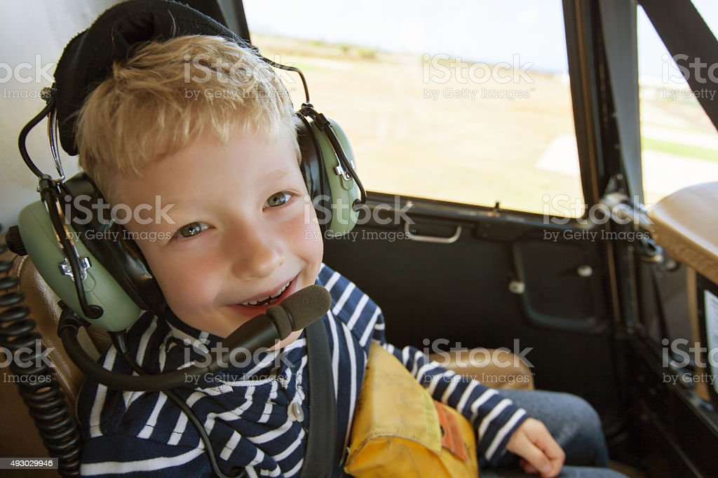 kid in helicopter stock photo
