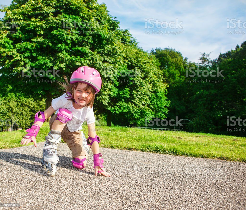 Kid in pink protective sportswear stock photo