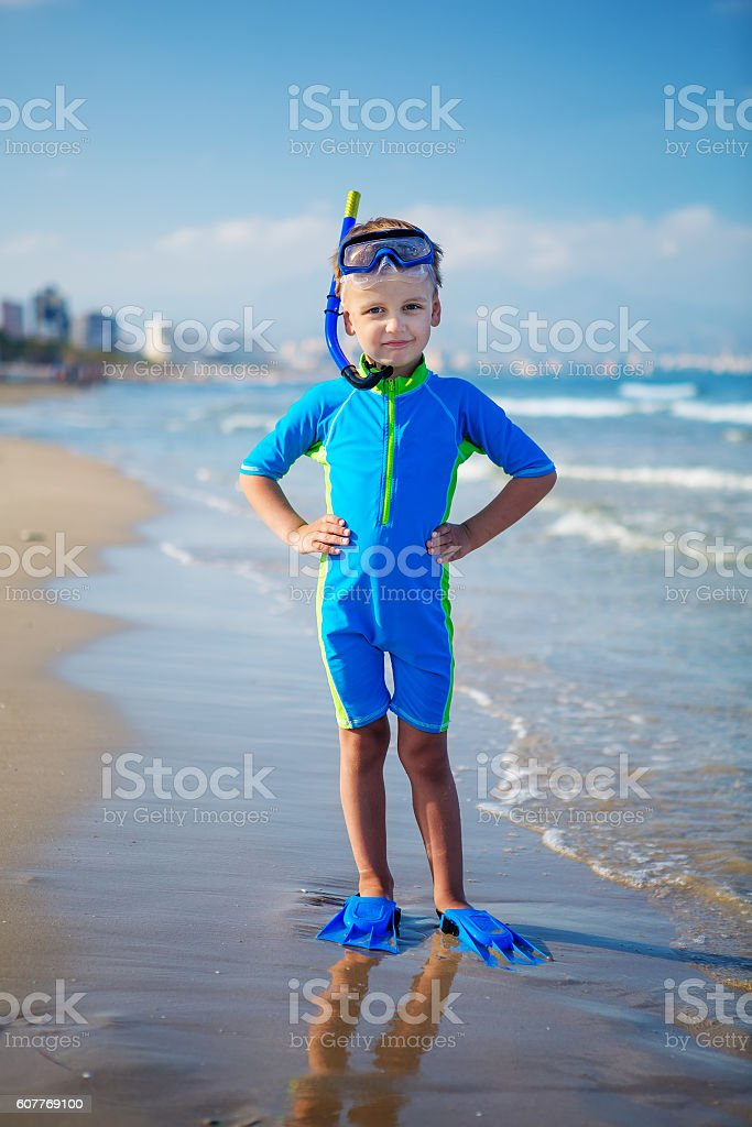 Kid in swimming suit is ready for snorkeling stock photo