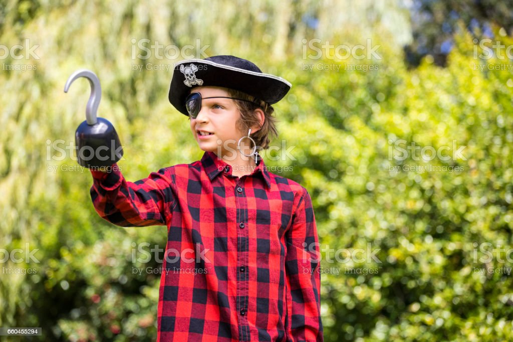 A kid is playing in costume of pirate royalty-free stock photo